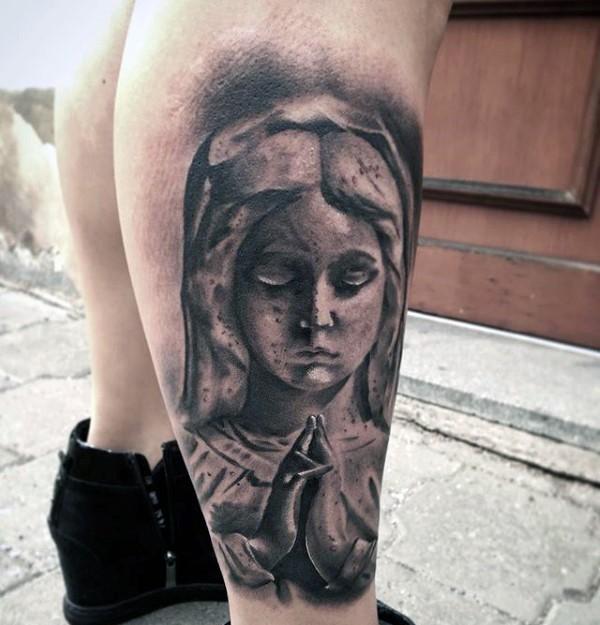 Stonework style black ink leg tattoo of praying woman statue