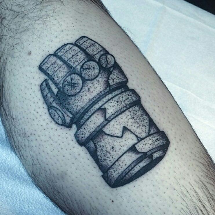 Stonework style black ink leg tattoo of ancient glove