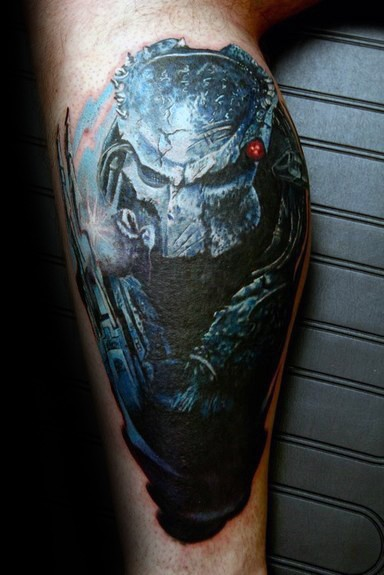 Stonework style colored leg tattoo of Predator statue