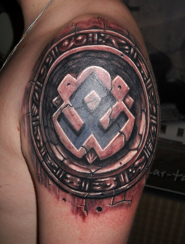 Stonework style colored shoulder tattoo of ancient tablet