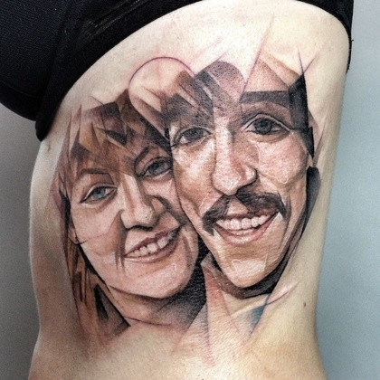 Stonework style colored side tattoo on happy couple