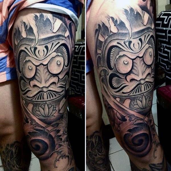 Stonework style colored thigh tattoo of daruma doll statue