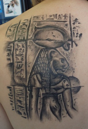 Stonework style detailed scapular tattoo of ancient Egypt wall picture