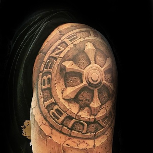 Stonework style detailed shoulder tattoo of big sculpture
