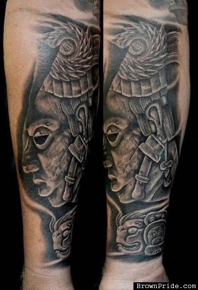 Stonework style forearm tattoo of ancient stone statue