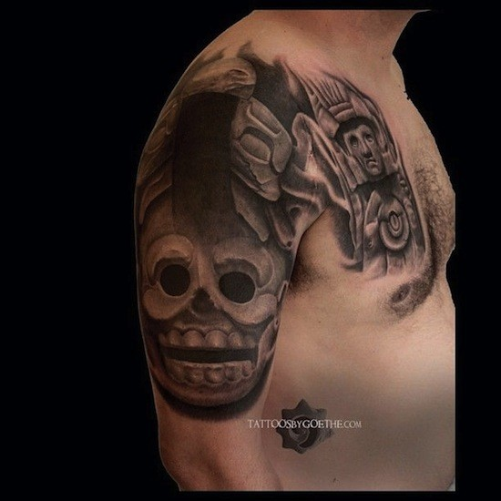 Stonework style large black and white shoulder and chest tattoo of ancient stone statues