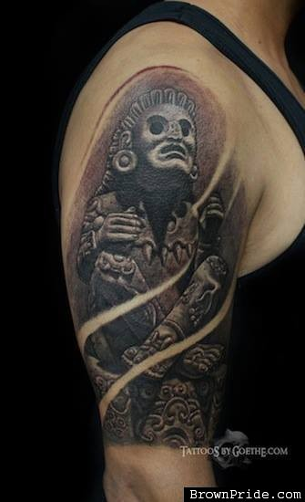 Stonework style shoulder tattoo of ancient statue