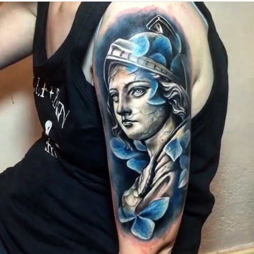 Stonework style shoulder tattoo of antic statue