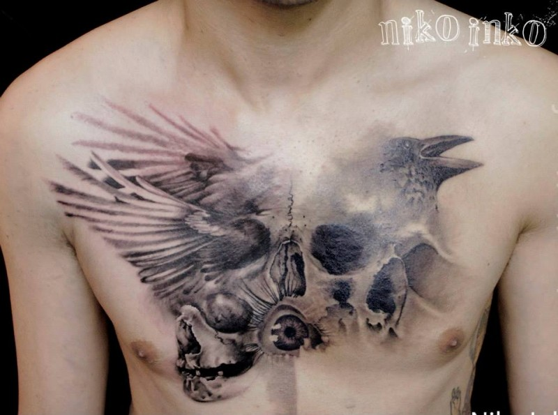 Strange combined and detailed chest tattoo oof human skulls with flying crow