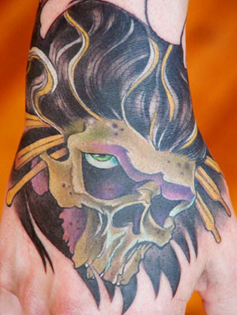 Strange designed colored hand tattoo of human skull shaped mask