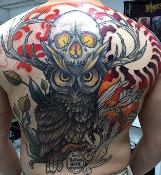 Strange designed colorful owl with deer horns tattoo on back with demonic skull