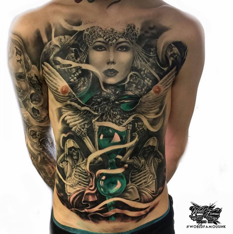 Strange looking colored chest and belly tattoo of woman with sand clock and skeletons