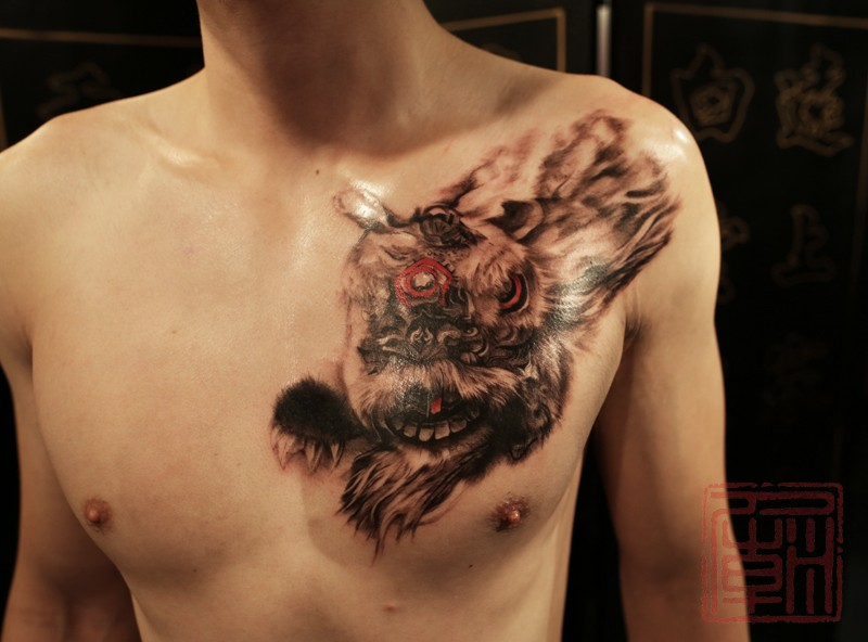 Strange looking colored chest tattoo of flying fantasy for Color chest tattoos