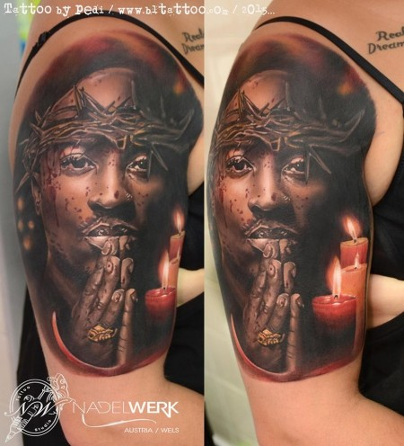 Strange looking colored shoulder tattoo of 2PAC with candle and vine