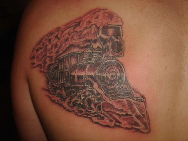 Strange looking large train tattoo on scapular