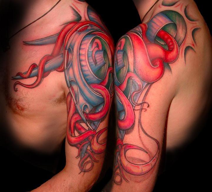 Strange painted colorful alien like tattoo on shoulder
