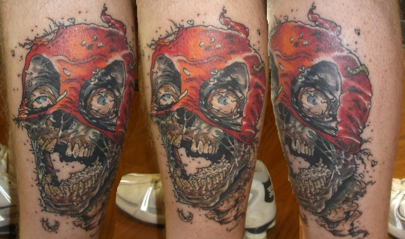 Stunning 3D like colorful very detailed leg tattoo on evil zombie skull