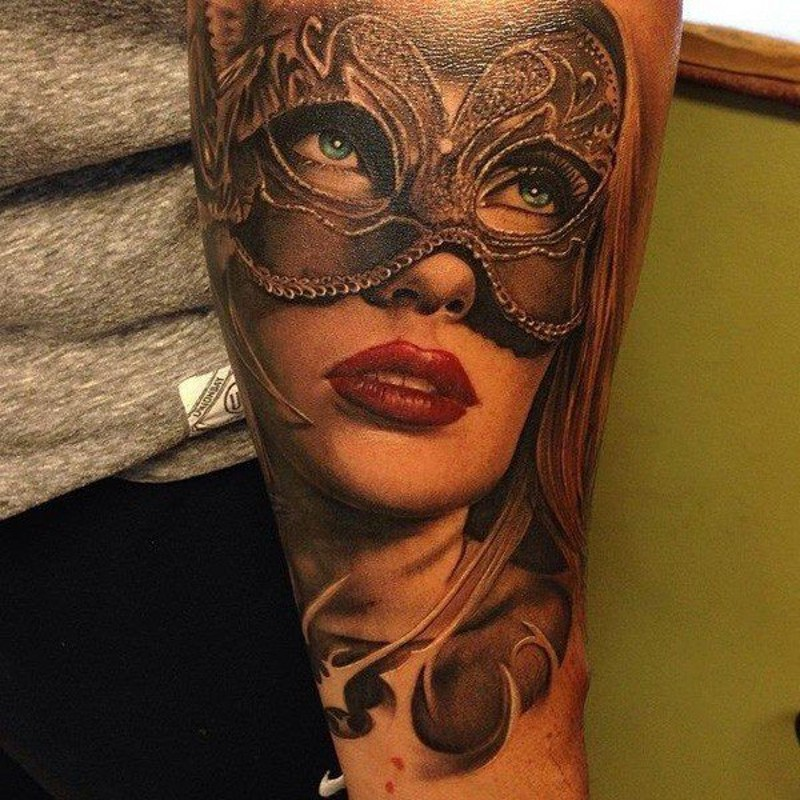 Stunning accurate painted detailed beautiful forearm tattoo of woman in mask
