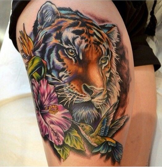 Stunning accurate painted thigh tattoo of tiger portrait with flowers and birds