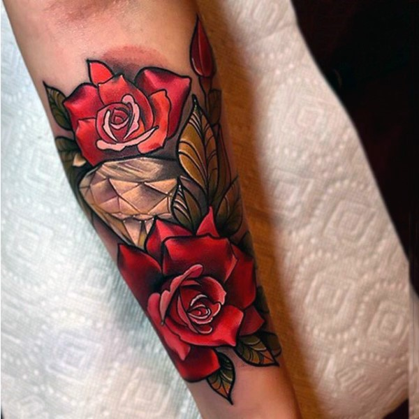 Stunning beautiful colored diamond with rose flower tattoo on arm