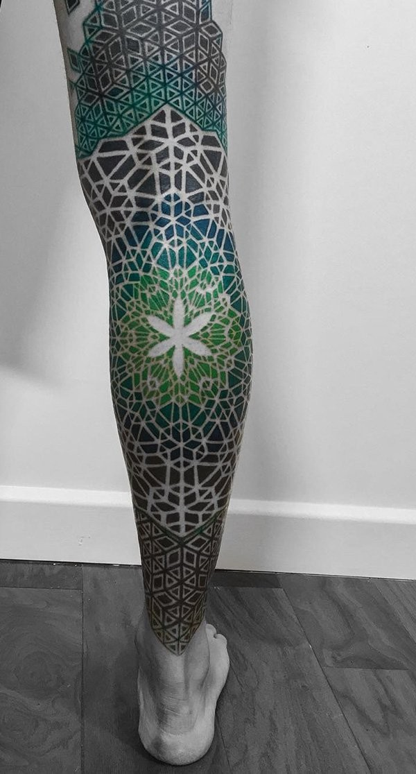 Stunning big multicolored tribal ornaments tattoo on whole leg with flower