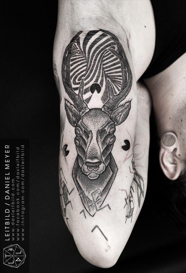 Stunning black and white alien like creepy deer tattoo on arm