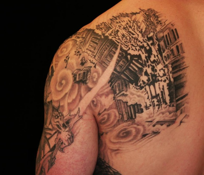 Stunning black and white back and shoulder tattoo of corrupted city