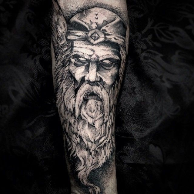 Stunning black and white forearm tattoo of man with beard
