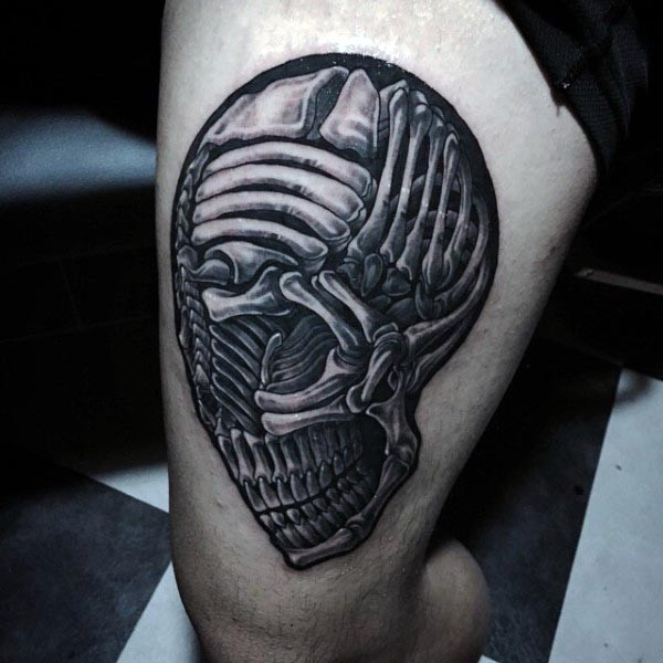 Stunning black and white futuristic looking thigh tattoo of alien skull