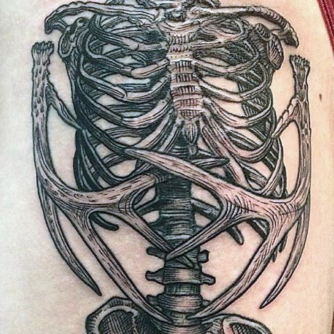 Stunning black and white human skeleton with deer horns tattoo