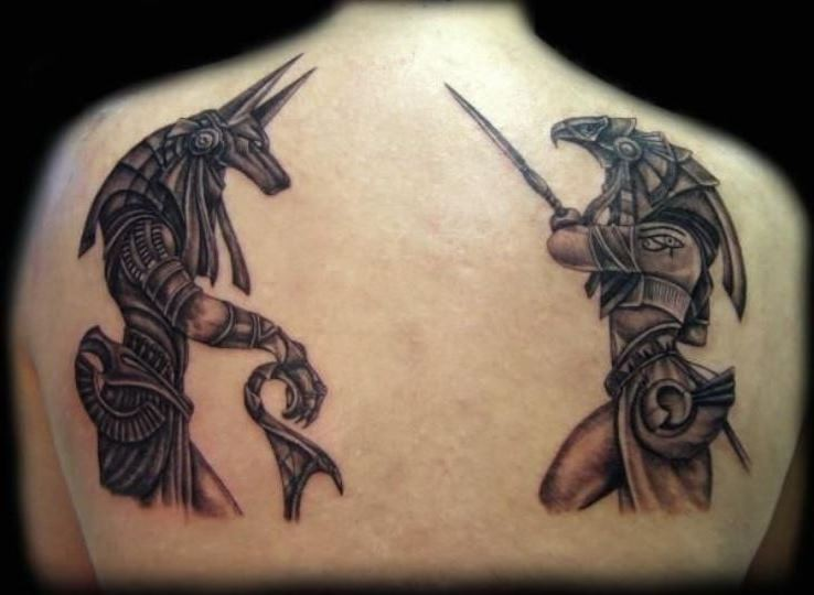 Stunning black ink detailed looking back tattoo of various Egypt Gods statues