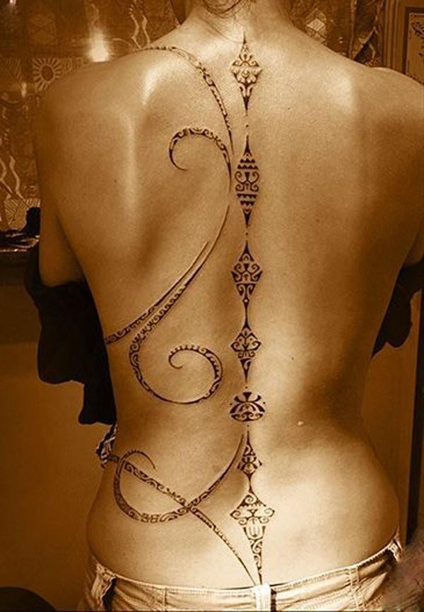 Stunning black ink elegant tribal style tattoo on whole back