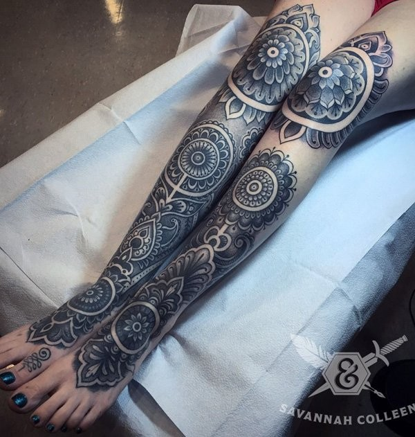 Stunning black ink identical floral tattoos on both legs