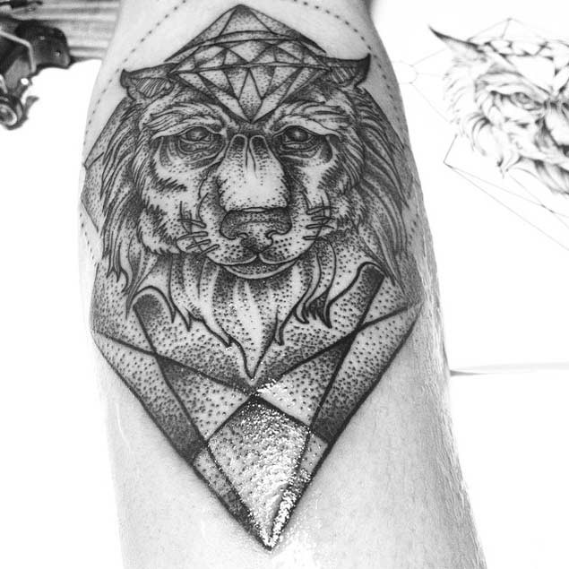 Stunning black ink magical old wolf face tattoo combined with diamonds