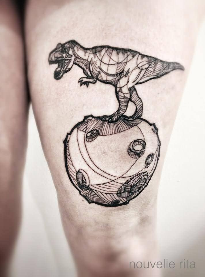 Stunning black ink thigh tattoo of dinosaur and planet