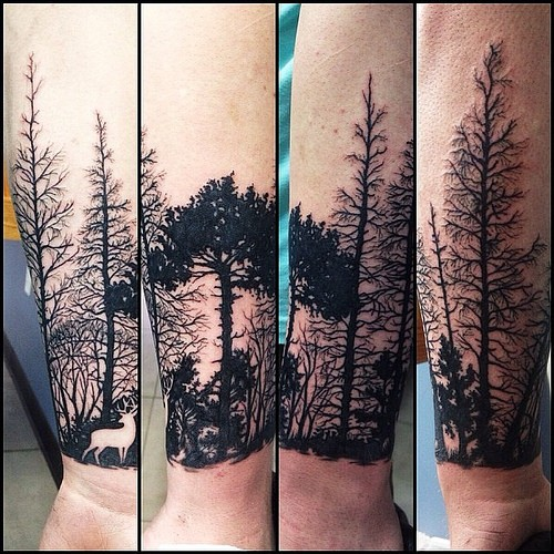 Stunning blackwork style forearm tattoo of forest with deer