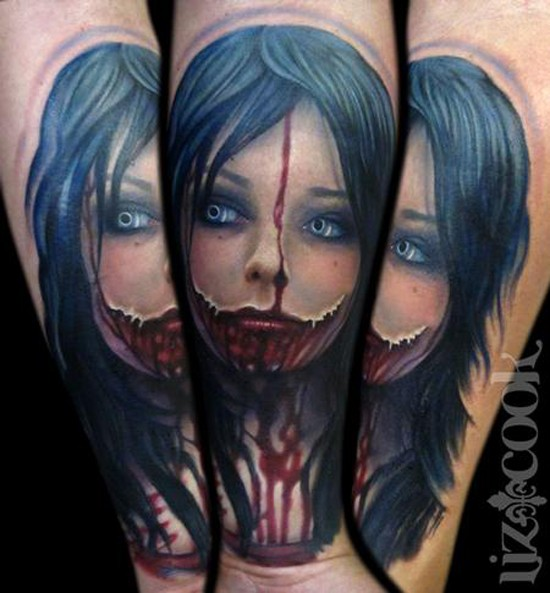 Stunning bloody colored horror girl tattoo on arm