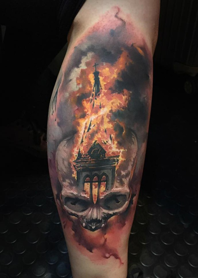 Stunning colored arm tattoo of burning church with human skull