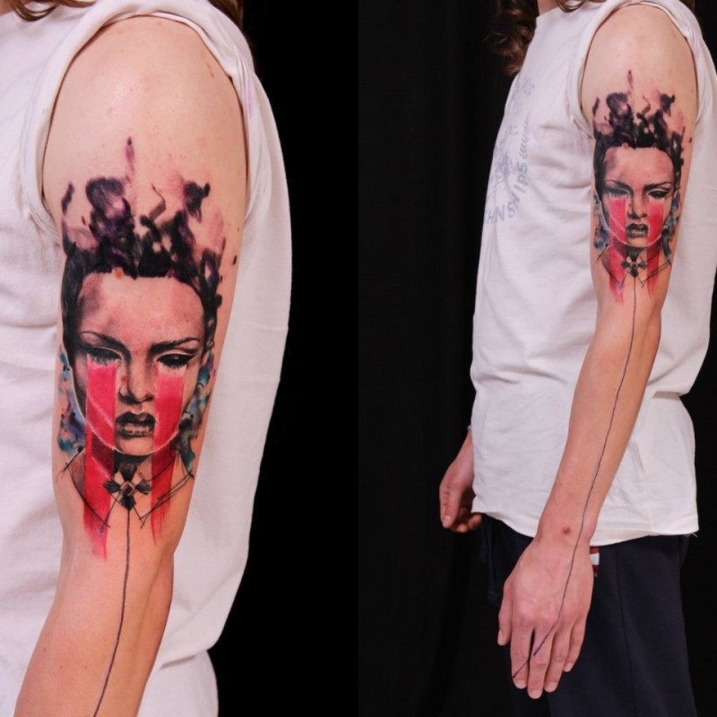 Stunning colored shoulder tattoo of demonic woman portrait and black line