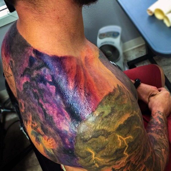 Stunning colorful natural looking wild life lightnings tattoo on shoulder and back