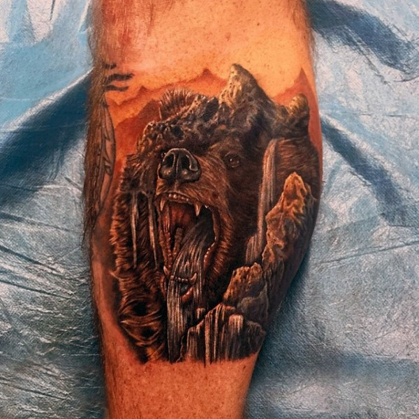 Stunning designed and colored bear head shaped waterfall tattoo on leg