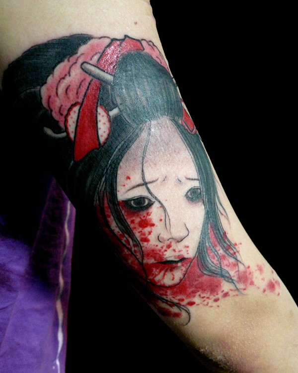 Stunning designed and painted Asian geisha bloody head tattoo on arm