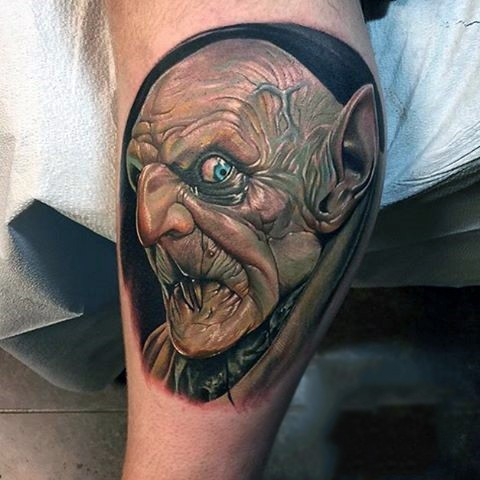 Stunning detailed and colored fantasy vampire tattoo on leg