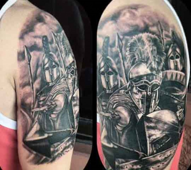 Stunning detailed black and white various ancient warriors tattoo on upper arm