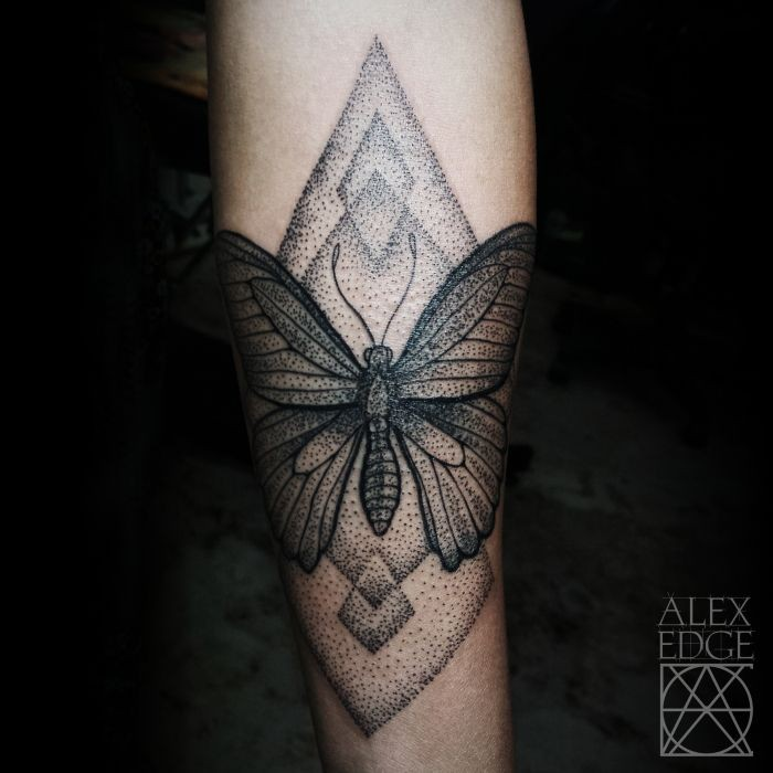 Stunning dotwork style arm tattoo of large butterfly