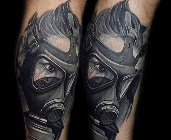 Stunning gray washed style detailed man in gas mask tattoo on arm