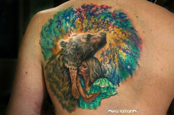Stunning illustrative style colored back tattoo of woman with bear