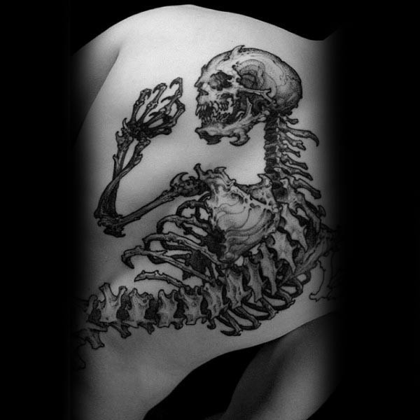 Stunning large black ink whole back tattoo of demonic human skeleton