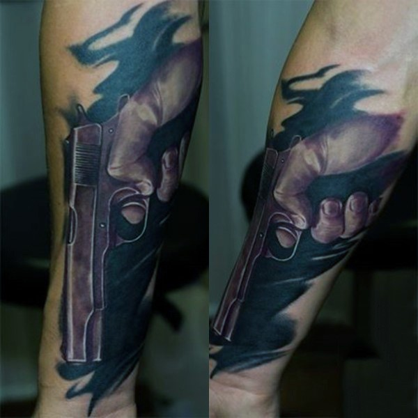 Stunning looking colored realism style forearm tattoo of hand holding pistol