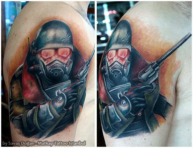 Stunning looking colored shoulder tattoo of mystical soldier in gas mask